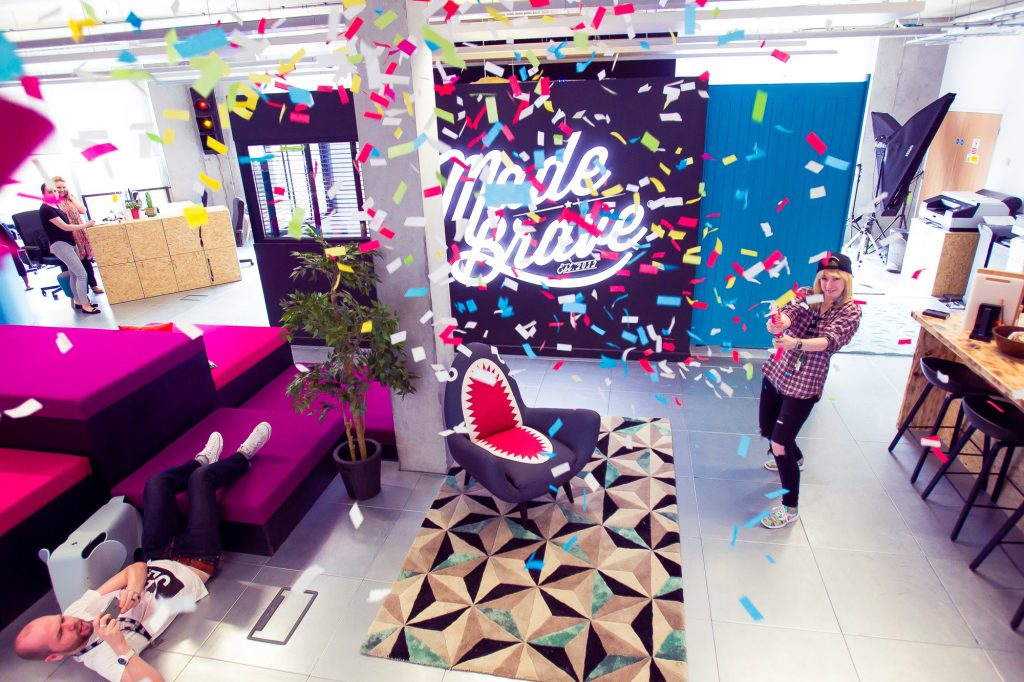 MadeBrave office with falling confetti