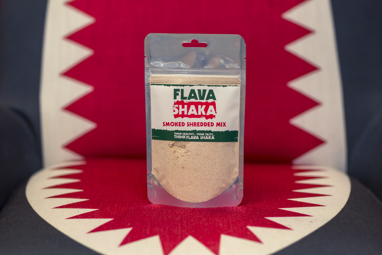 flava shaka packet sitting in the open mouth shark chair