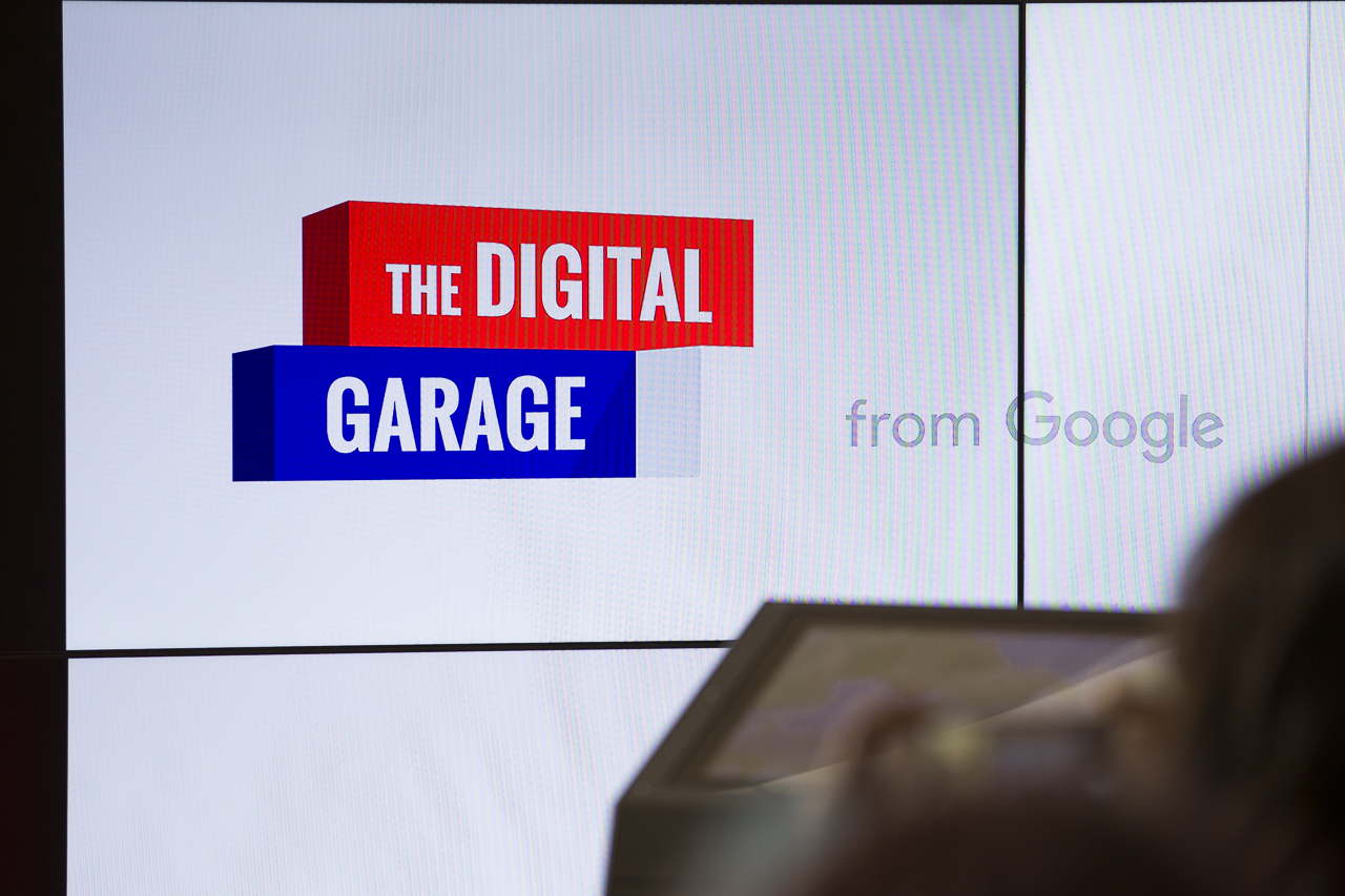 Google digital garage logo on a presentation screen