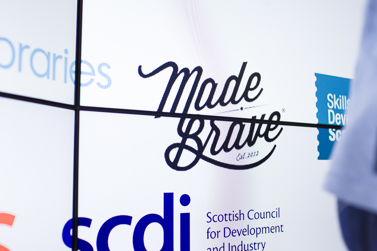 madebrave logo on a board with fellow partner logos of Google Digital Garage Glasgow